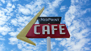 The neon sign of the Midpoint Cafe.