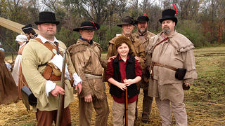 Jack Cantrell poses in costume with historic reenactors.