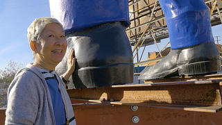 Amy Inouye with Chicken Boy, the statue she rescued on Route 66 in Los Angeles, CA.