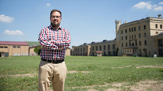 Historian Greg Peerbolte stands outside old Joliet prison in Joliet, Illinois.