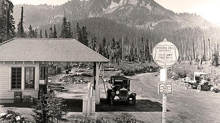 A car stops at a gas station at Stevens Pass in 1926.