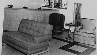 Black and white photo of the Blue Swallow Motel's lobby, circa 1949.