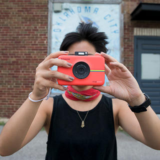 Roadie Lina Tran takes a picture along Route 66 in Oklahoma with her Polaroid camera.
