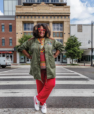 Michelle Browder stands in front of the Kress on Dexter in Montgomery, Alabama