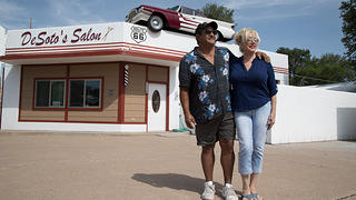 Edie and Jose DeSoto stand outside their Salon in Ash Fork, Arizona.