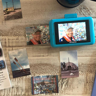 Photo spread of Polaroid photos and Route 66 curios.