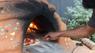 A pizza oven brings neighbors over.
