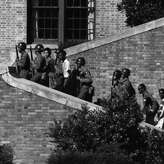 101st Airborne troops accompany students to Little Rock Central High, 1957.