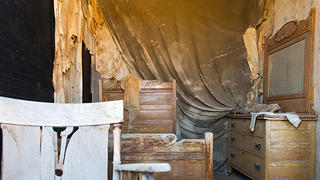One of the bedrooms at Bodie looks like the residents just got up and left.