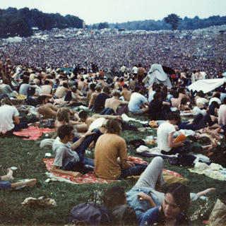 Photo of the crowd at the 1969 Woodstock music festival, with the Bindy Woods to the left.