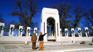 Benson stands at the World War II Memorial in construction in 2003.