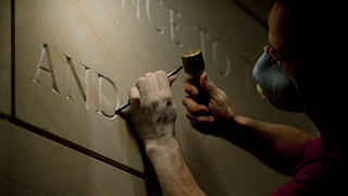 Stone letter Nick Benson carving onto the Capitol Visitor's Center in D.C.