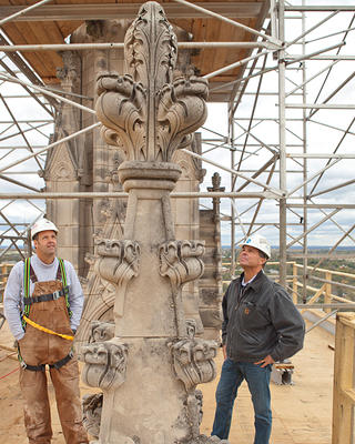 Alonso Inspects earthquake damage at Washington National Cathedral.