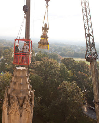 Stonecarver Andy Uhl and Alonso in a manbasket suspended over the Washington National Cathedral.