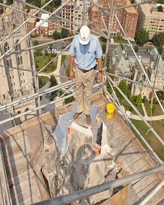Alonso stands on top of a broken pinnacle at Washington National Cathedral.