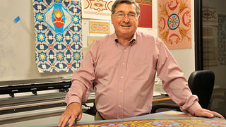 John Canning of John Canning Co. stands in his shop.