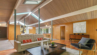 Open-plan living room of an Eichler home.