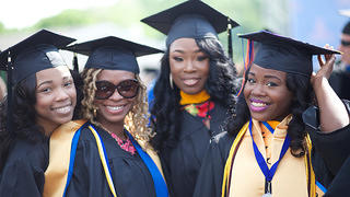 Recent Morgan State University graduates pose for a picture.