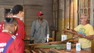 Students learn from preservation professionals during the HOPE Crew workshop at Tuskegee University