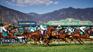 Horses thunder past the photographer at Santa Anita Park in California.