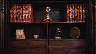 Bookshelf with books and other artifacts from Decatur's life and the Beale family.