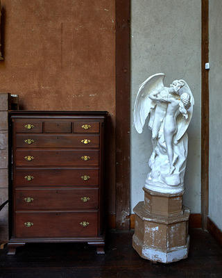 A corner detail of the Chesterwood studio with dresser and angel sculpture.