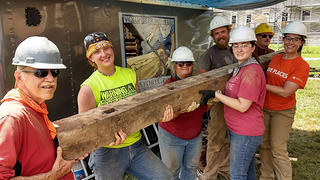 We hold the rotted beam up after removal on our last day at Shaker Village.