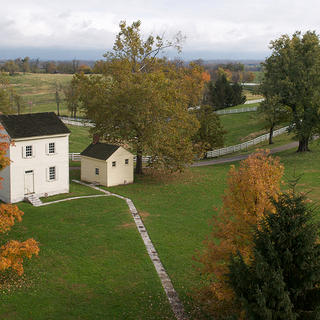 An aerial view of the water house with the bathing house nearby.