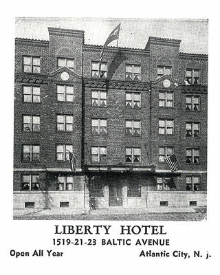 Postcard of Liberty Hotel exterior, a brick, six-story building.