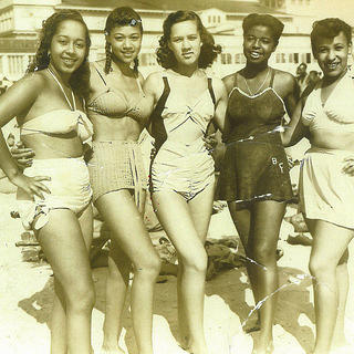 Five African American women in bathing costumes pose on Missouri Avenue Beach.