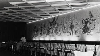 Interior of Moulin Rouge bar, May 20, 1955, with mural of cancan dancers on wall.
