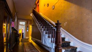 The main stairway in the Italianate Victorian home.