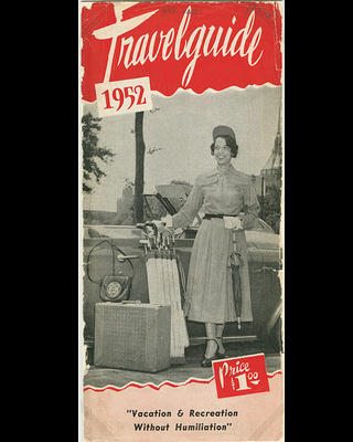 1952 edition of the Travelguide guide book. Features an African American model standing in front of a car.
