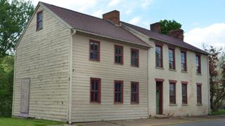 The street view of the John C. Plumer house. Its exterior is protected by a preservation easement.