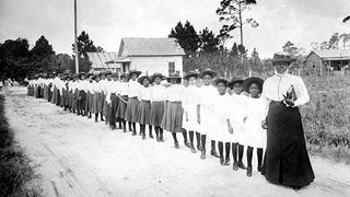 Mary McLeod Bethune leads a group of girls in her school in Florida.