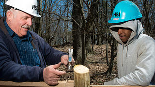 Ron Gartle shows corpsmember Andre Northern how to build a fence at Shenandoah National Park.