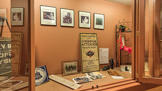 A display case with artifacts from the Attucks Theatre's history.
