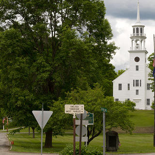 Strafford, Vermont, commons with white church and street signs pointing to other Vermont towns.