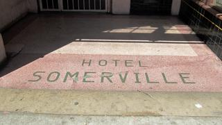 Inlaid tiles show the hotel's original name, Hotel Somerville.