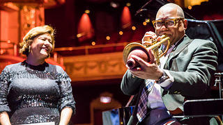 Elizabeth Alexander listens to Wynton Marsalis performs during the 2019 Action Fund summit.