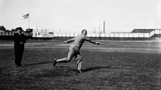 Ty Cobb throwing out the first pitch at Hamtramck Stadium on May 11, 1930.