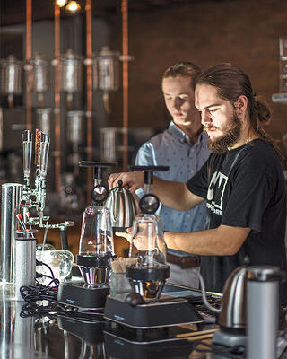 Zachary Swan, son of owners Darrin and Gina Swan, makes a cup of coffee.
