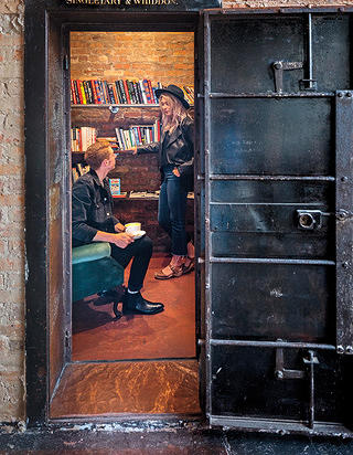 A vault belonging to the original farm supply company has been transformed into a reading nook.