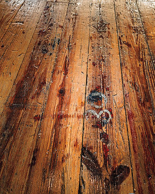 The Swans carefully preserved ruts, numbers, and other signs of wear in the wood floors.