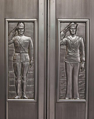 World War I doughboys on the Art Deco metal doors of the original elevator.