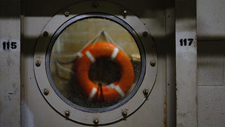 porthole window and life preserver