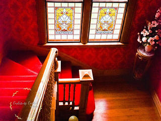 Stained glass windows above the staircase in the Edwards Swayze house.