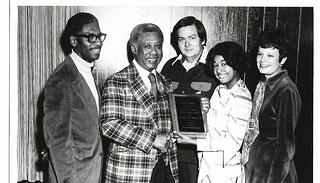 Jimmie McKee and his family accept an award.