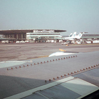 Historic photo from the vintage of the wing of a grounded plane towards the Pan Am flying saucer.