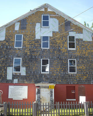 2009 image of the Abyssinian Meeting House in Portland, Maine. A two-story wood frame building in need of repairs.